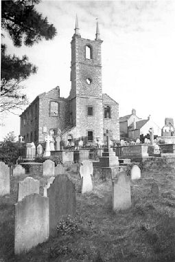 All that remained of St George's Church, Stonehouse, in 1942 was half of the tower and the four walls.